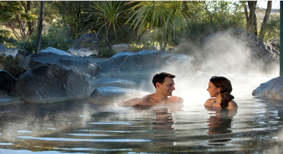 Two people relaxing in a hot mineral pool